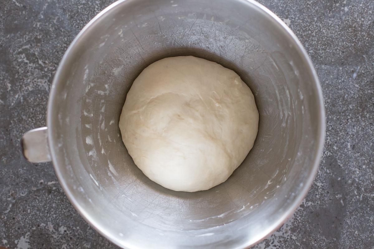 Fresh Buttery Garlic Breadsticks dough in mixer bowl.