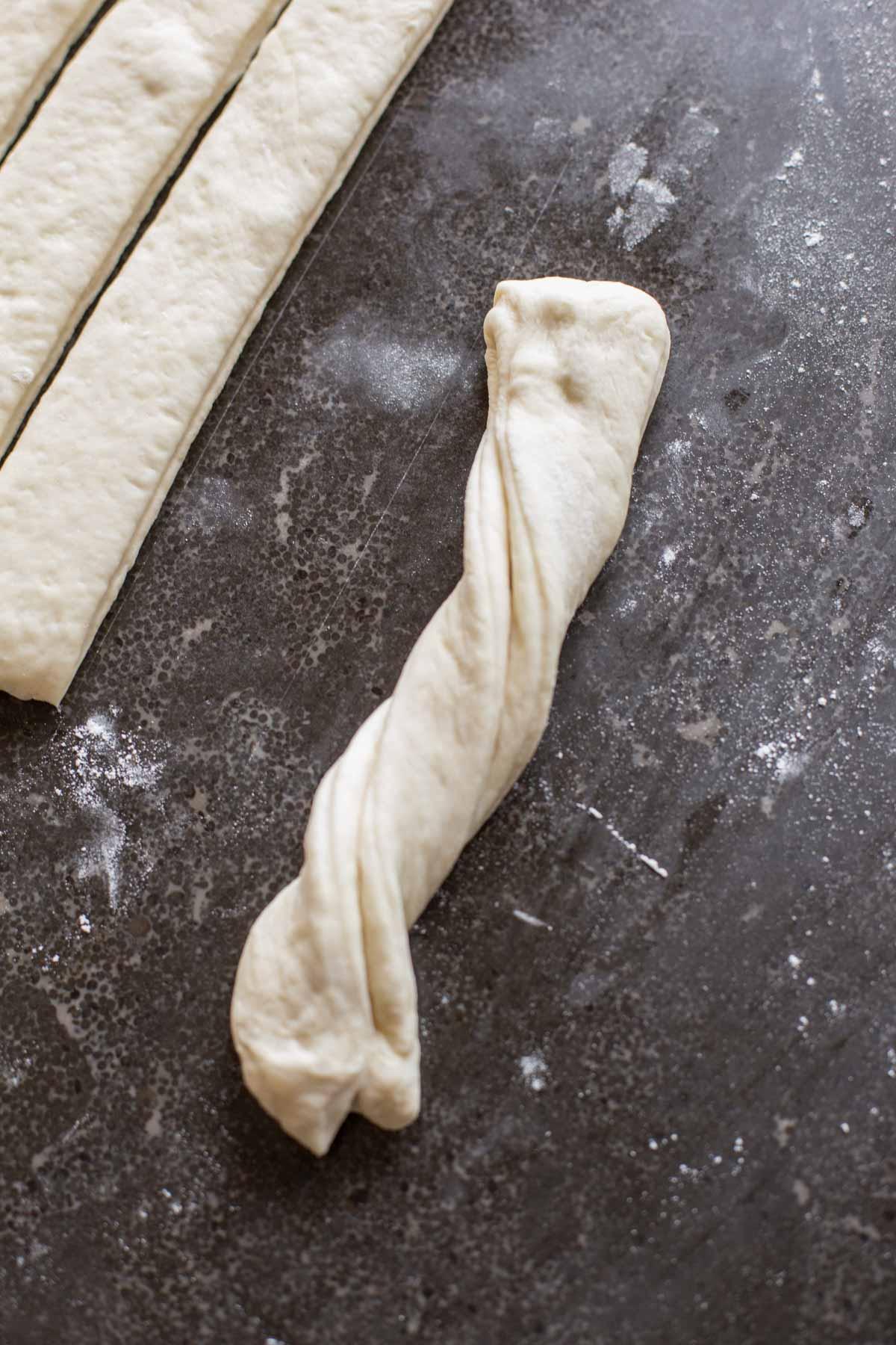 Fresh Buttery Garlic Breadsticks dough twisted.
