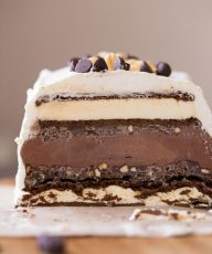 This Chocolate Peanut Butter Ice Cream Slice Cake is so clever, made with ice cream sandwiches, crunchy peanut butter ganache, and chocolate ice cream!