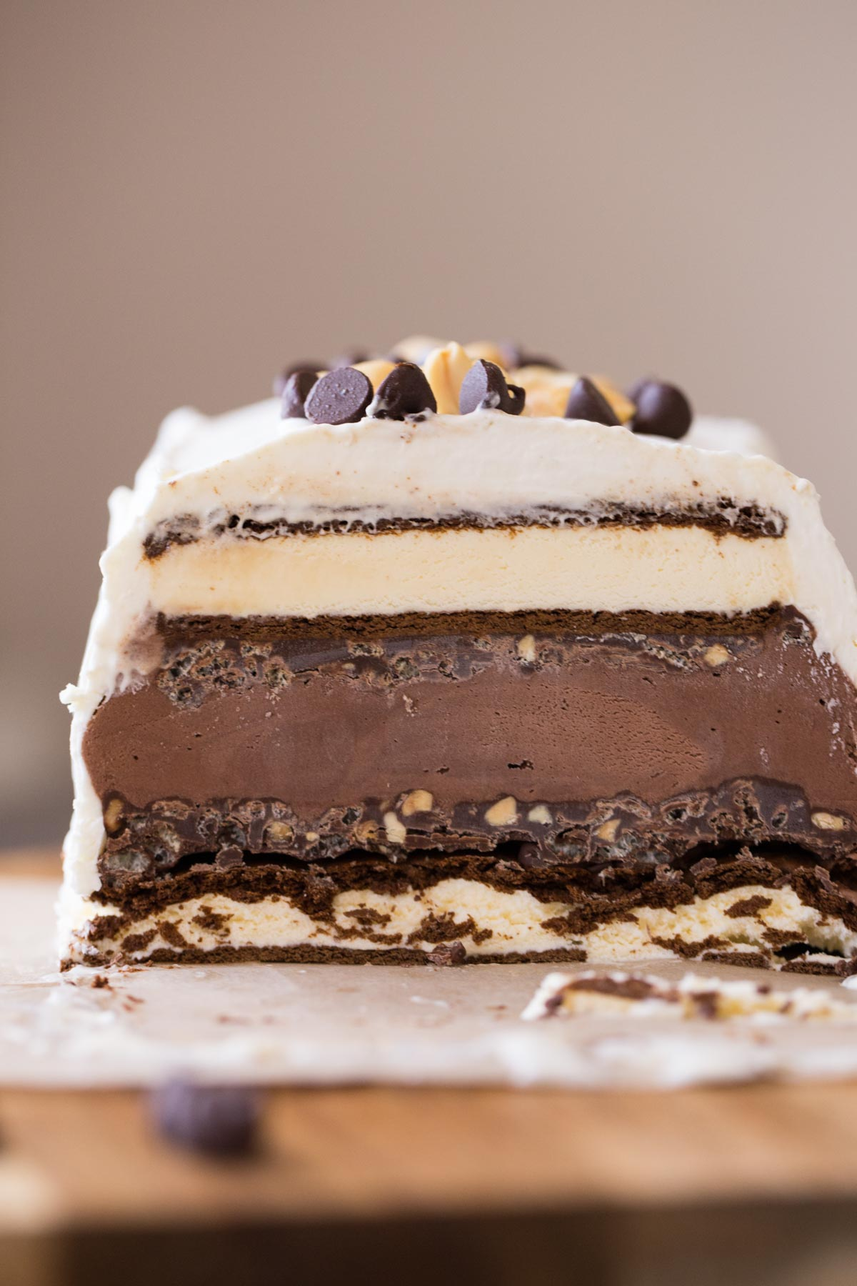 Chocolate Peanut Butter Ice Cream Slice Cake that has been sliced so it is showing the different layers.