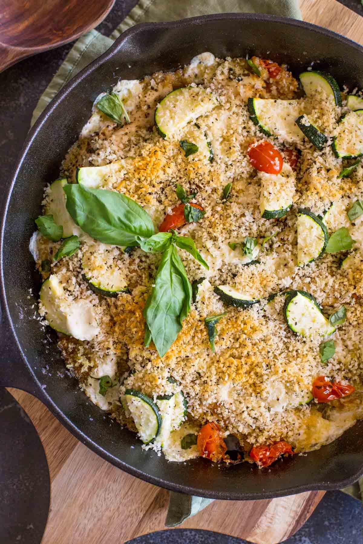 Pesto Chicken Skillet garnished with some fresh basil.