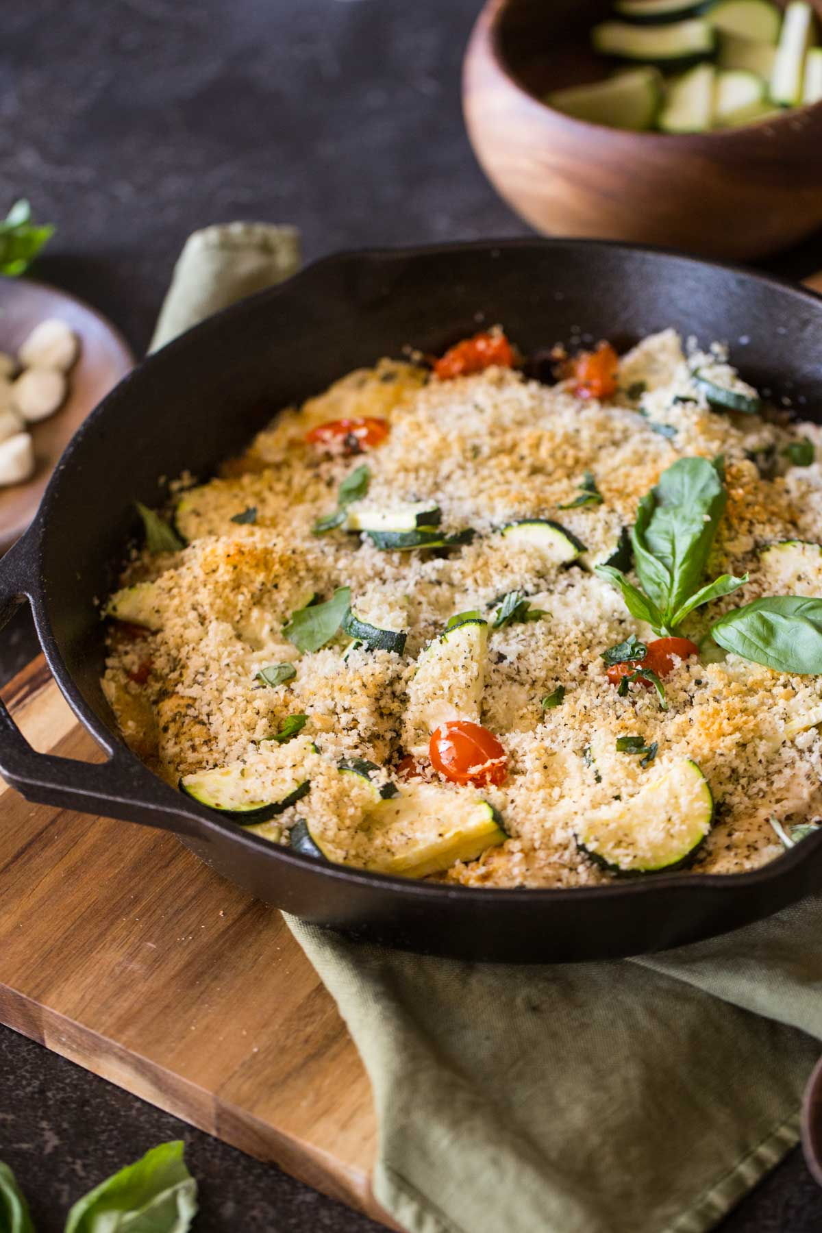 This Pesto Chicken Skillet could not be more perfect for summer with caramelized cherry tomatoes, plus zucchini and basil too.