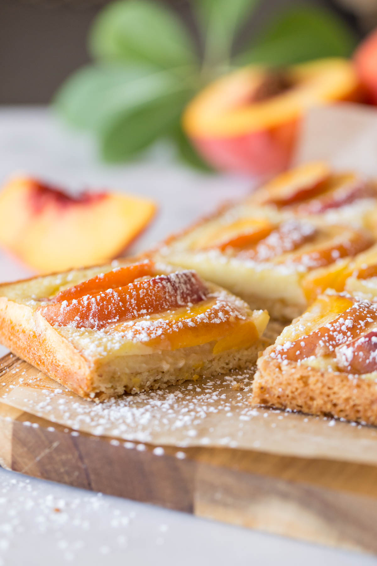 Peaches and Cream Shortbread Bars on a cutting board.