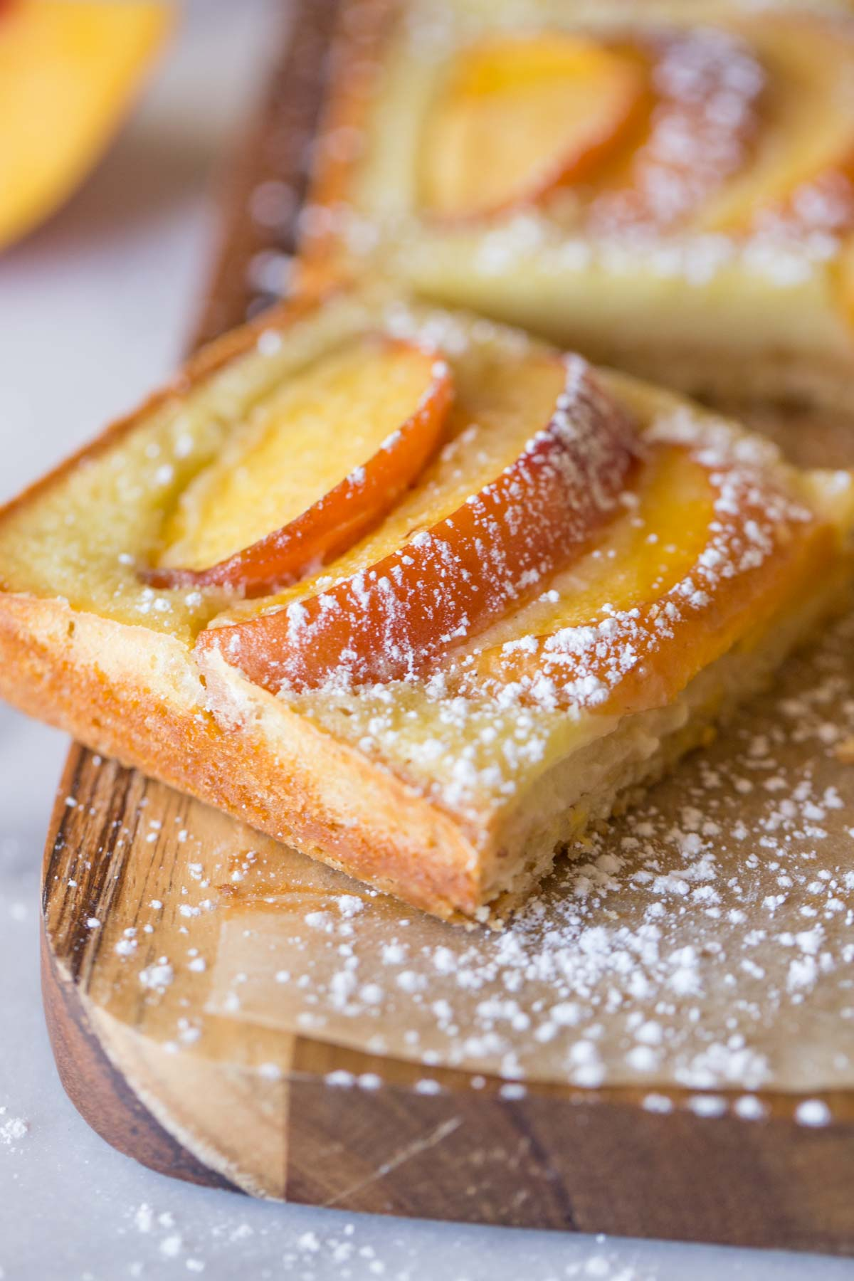 Peaches and Cream Shortbread Bars on a cutting board.