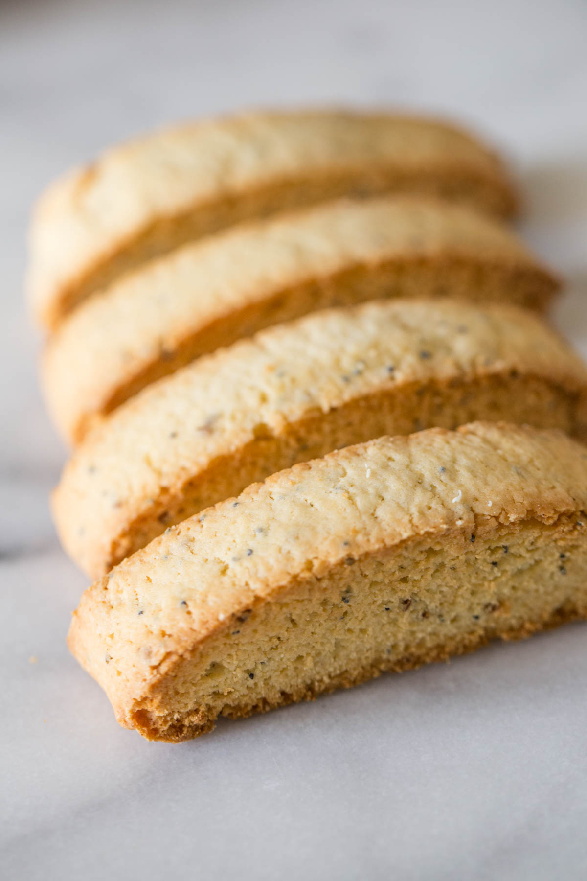 Four Almond Poppy Seed Biscotti slices without the white chocolate dip.