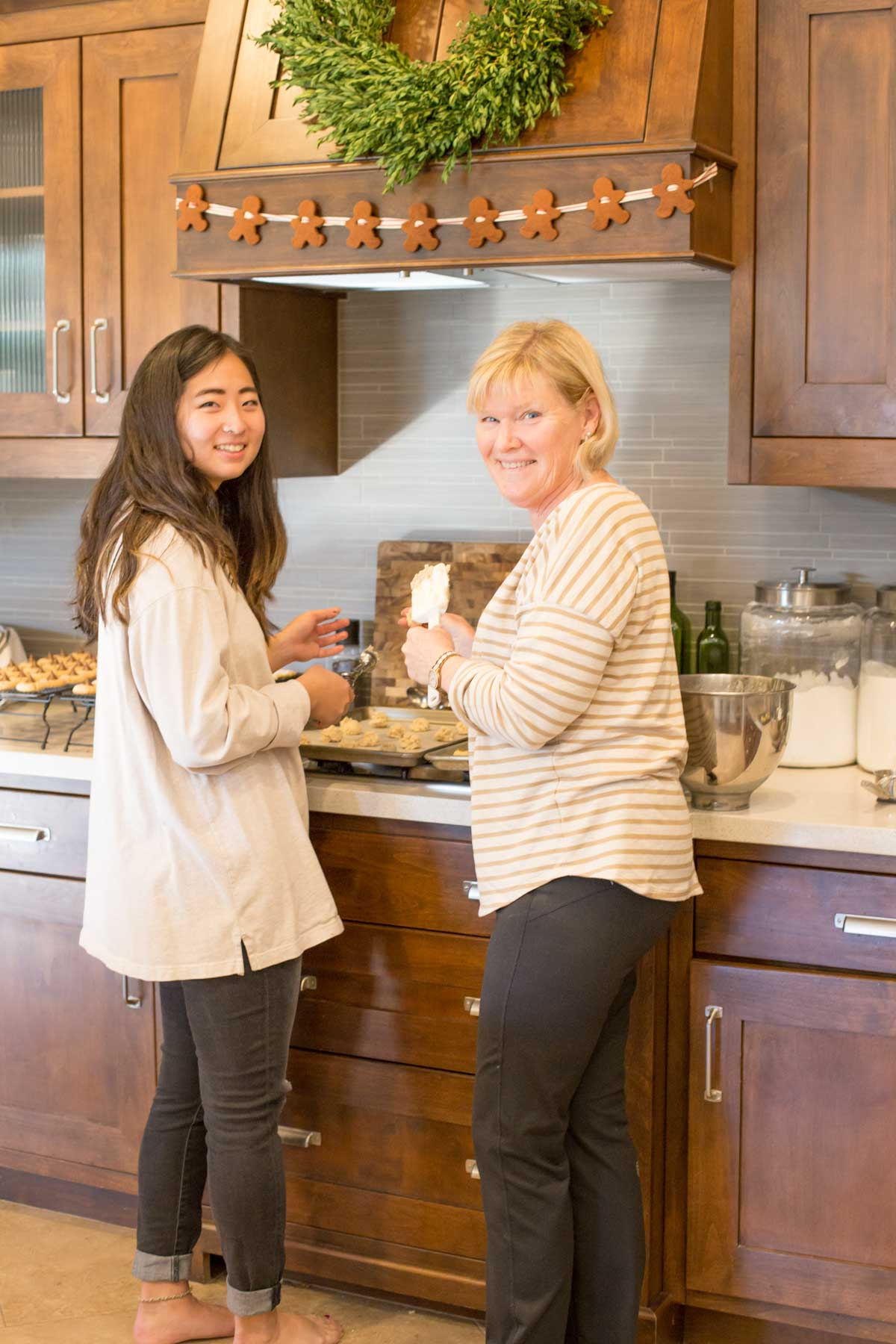 Two ladies in the kitchen making cookies.