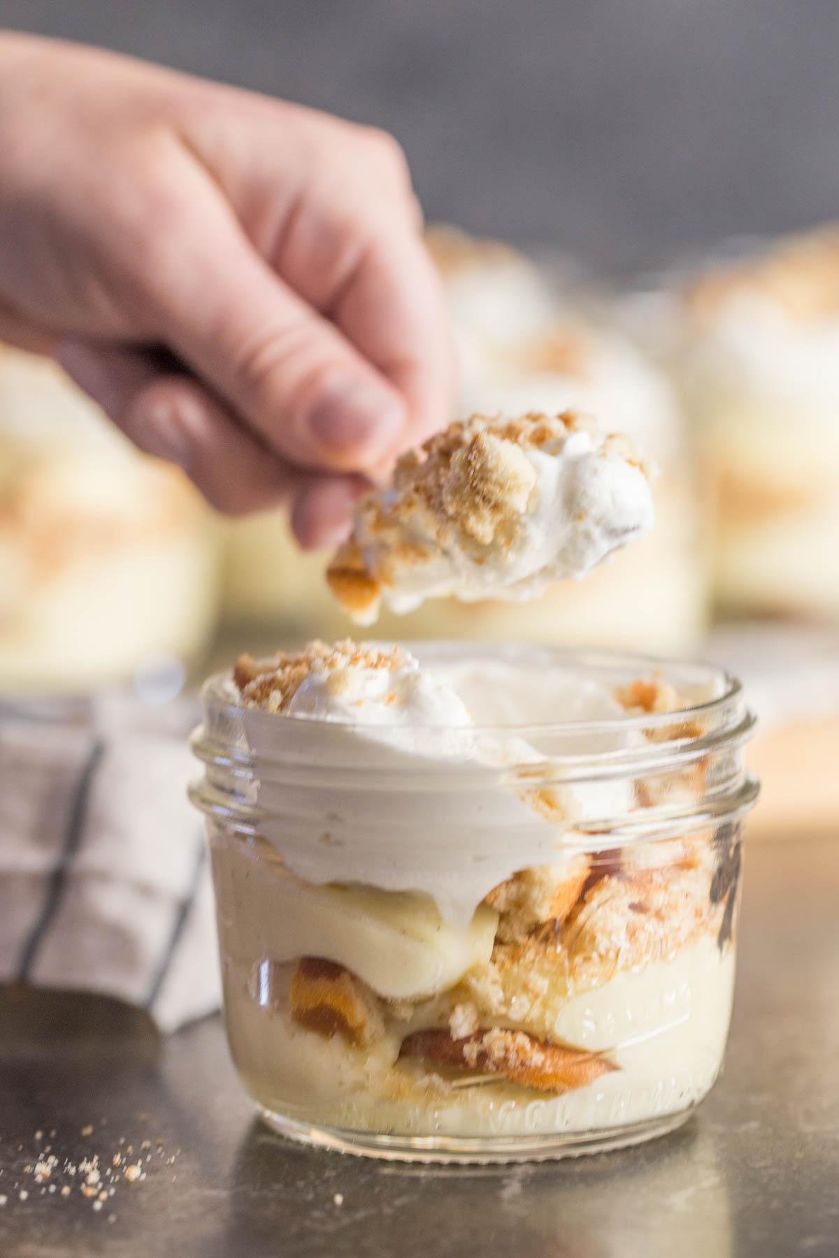 Spoonful of banana pudding above jar