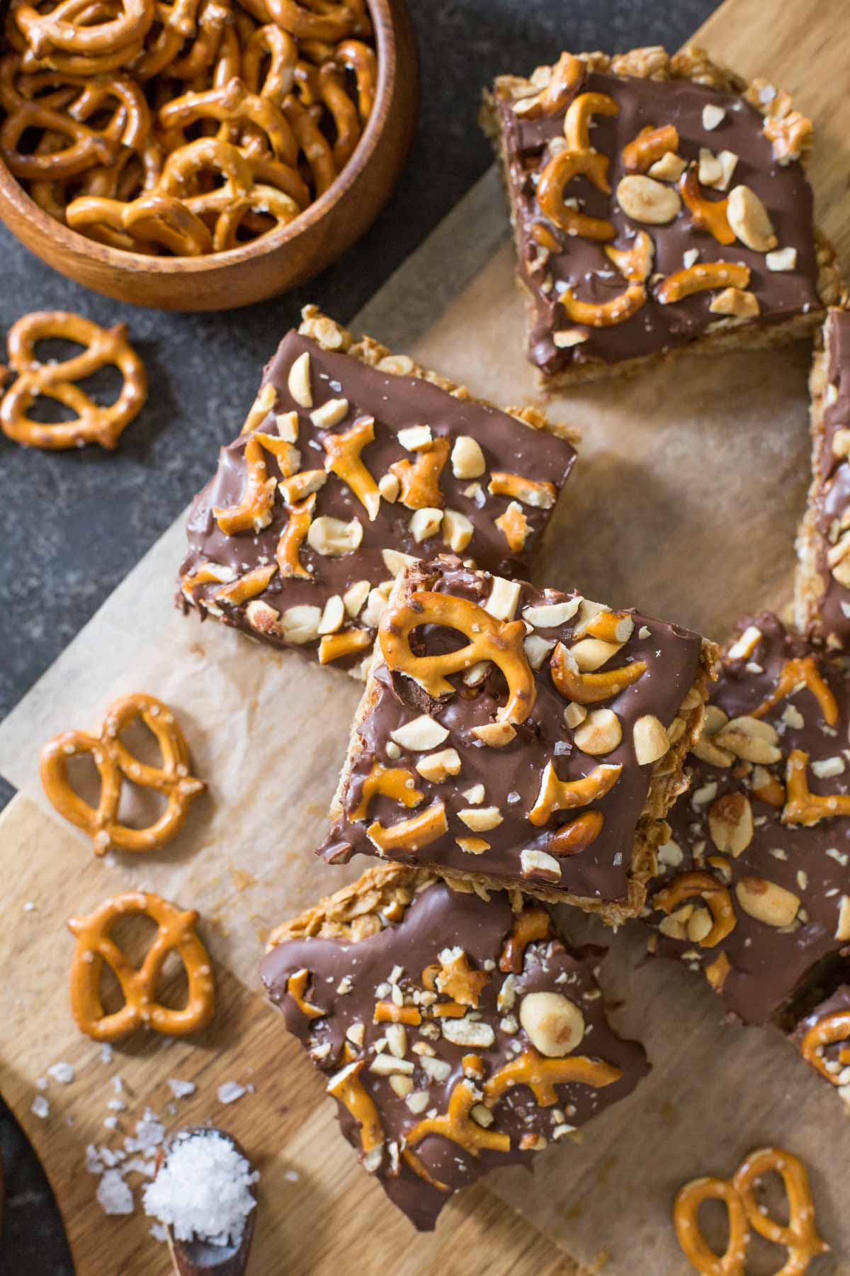 A top down view of cut Oh Henry Bars with pretzels and sea salt scattered around