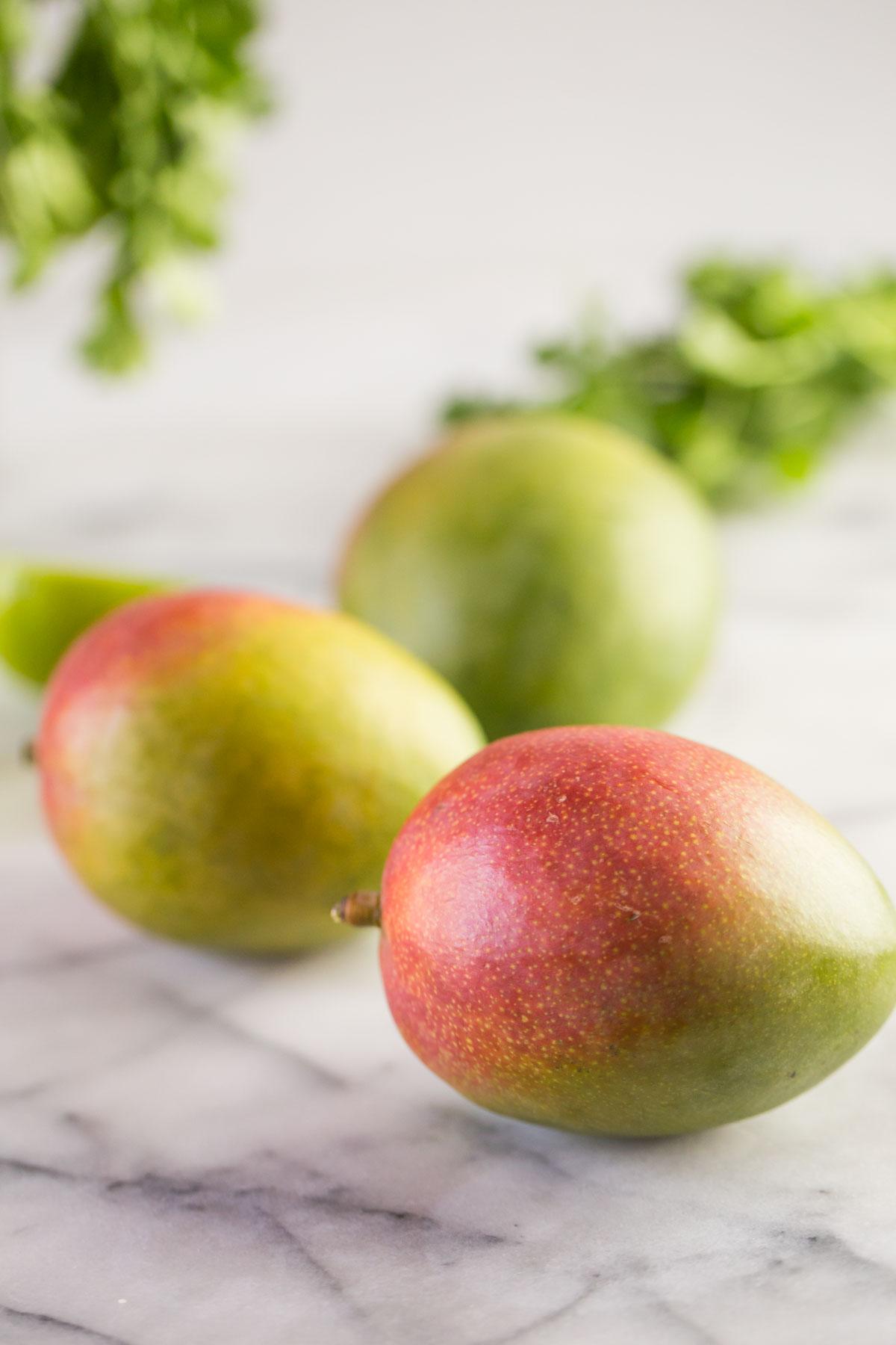 Three whole mangos.
