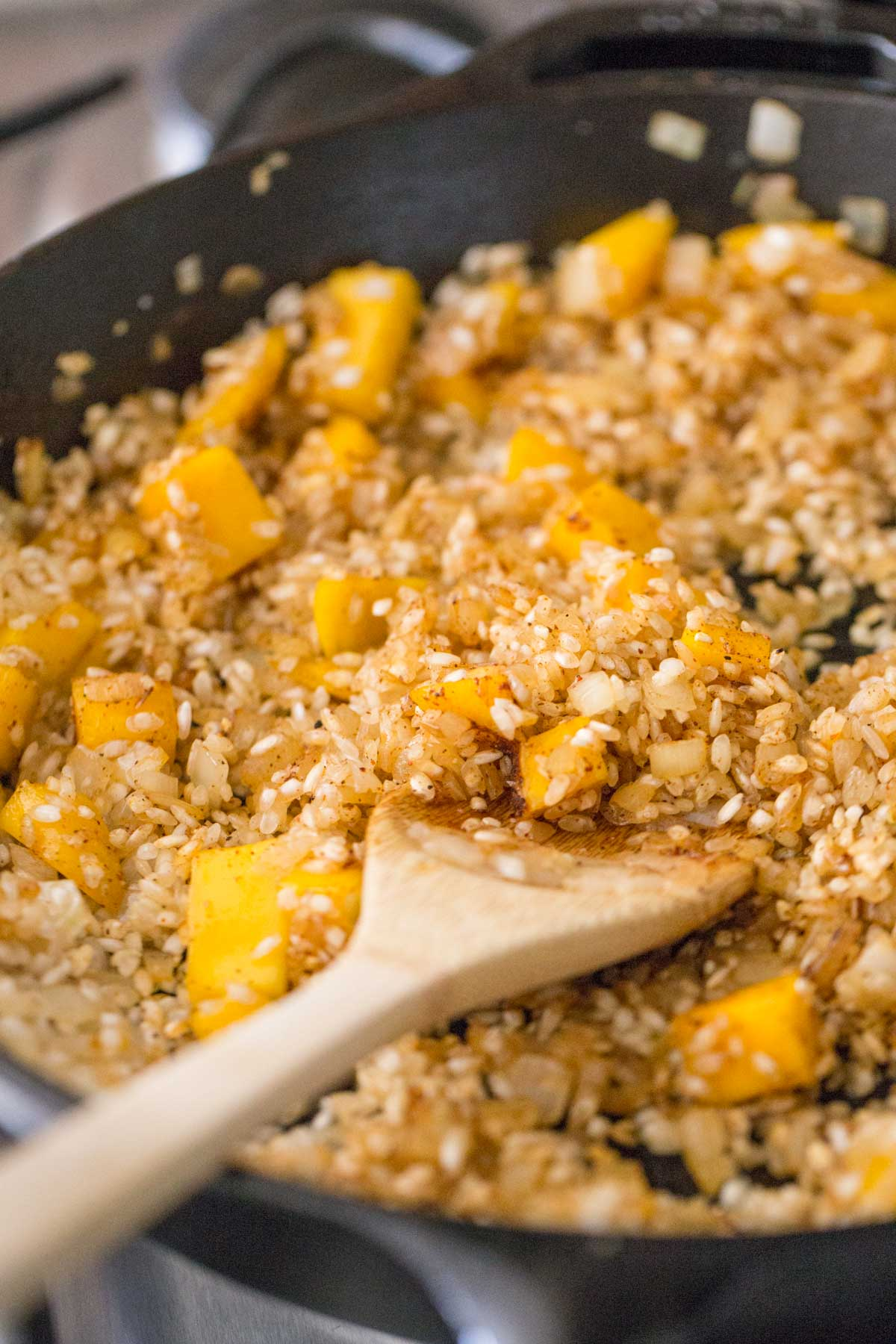 The rice mixture with the mangos in the skillet for the Chili Lime Mango Chicken and Rice.