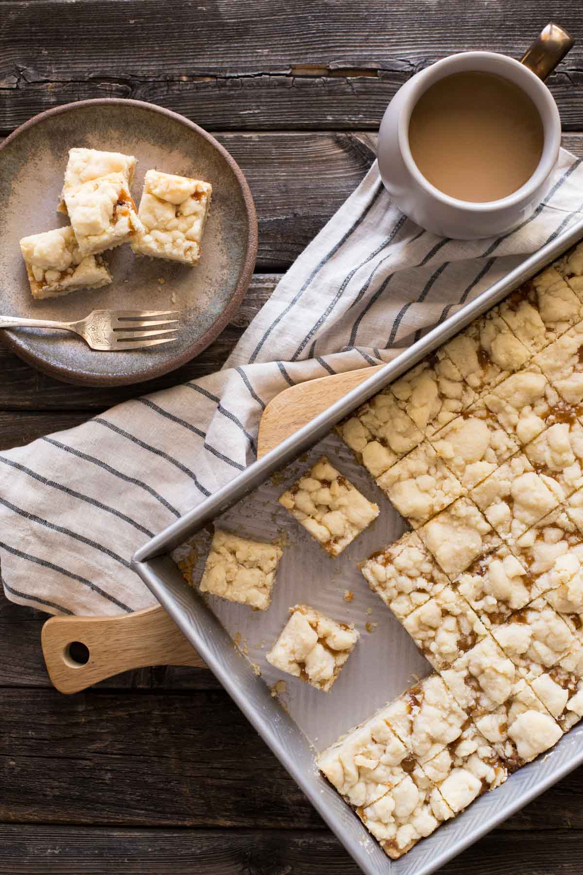 Overhead shot of Buttery Salted Caramel Bars on a wooden background.
