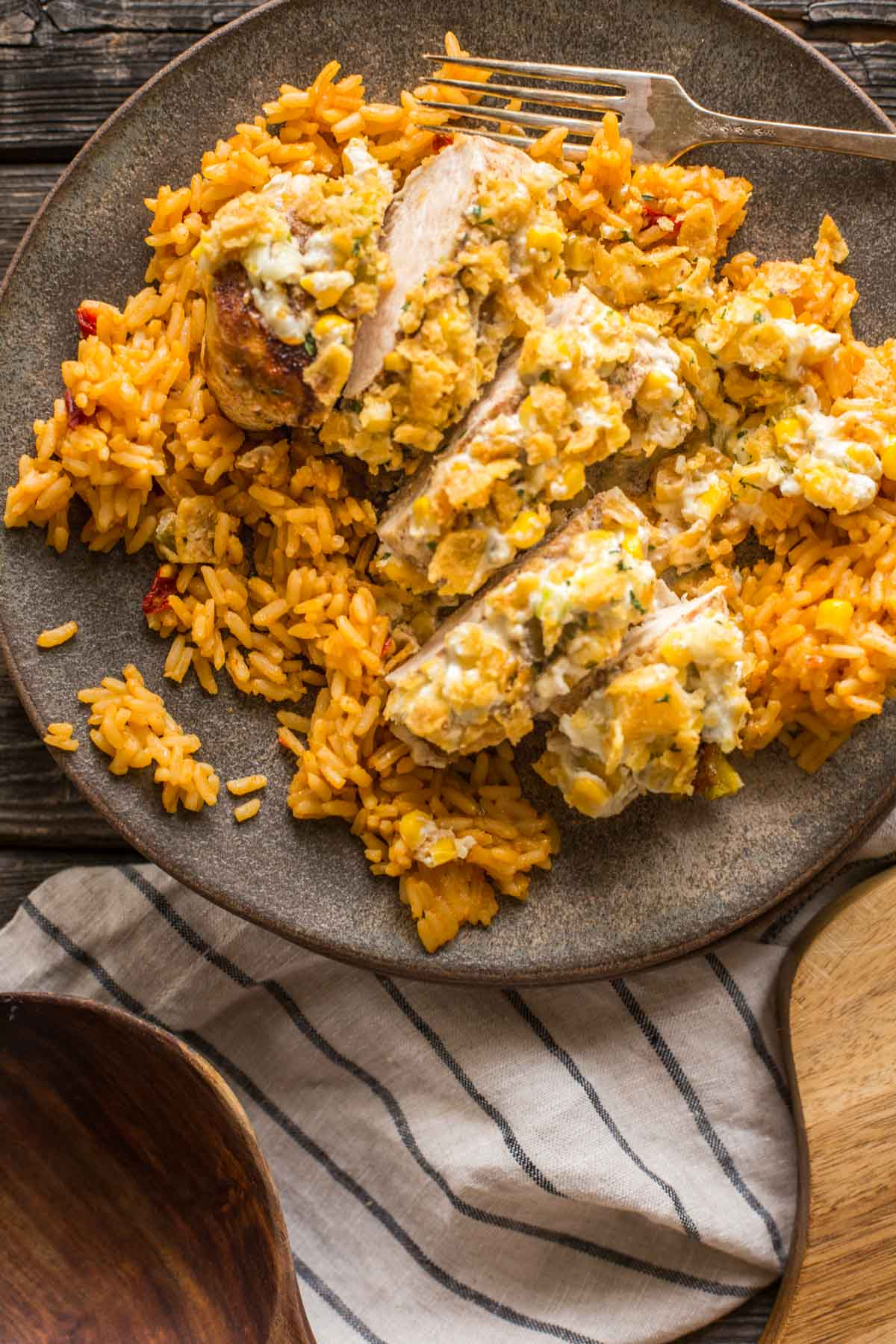 Sliced Creamy Cheesy Frito Chicken Skillet served on a bed of rice.