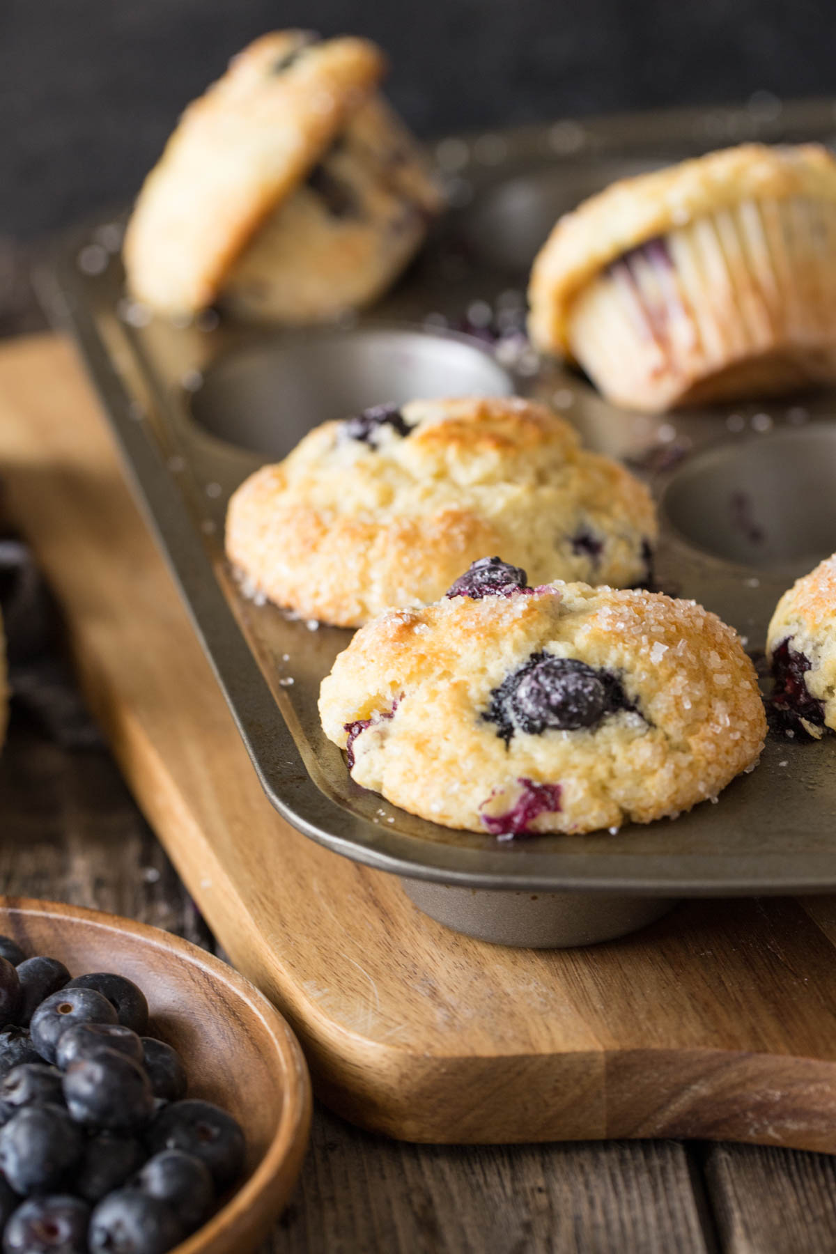 A close up view of Best Ever Buttermilk Blueberry Muffins in a muffin pan.