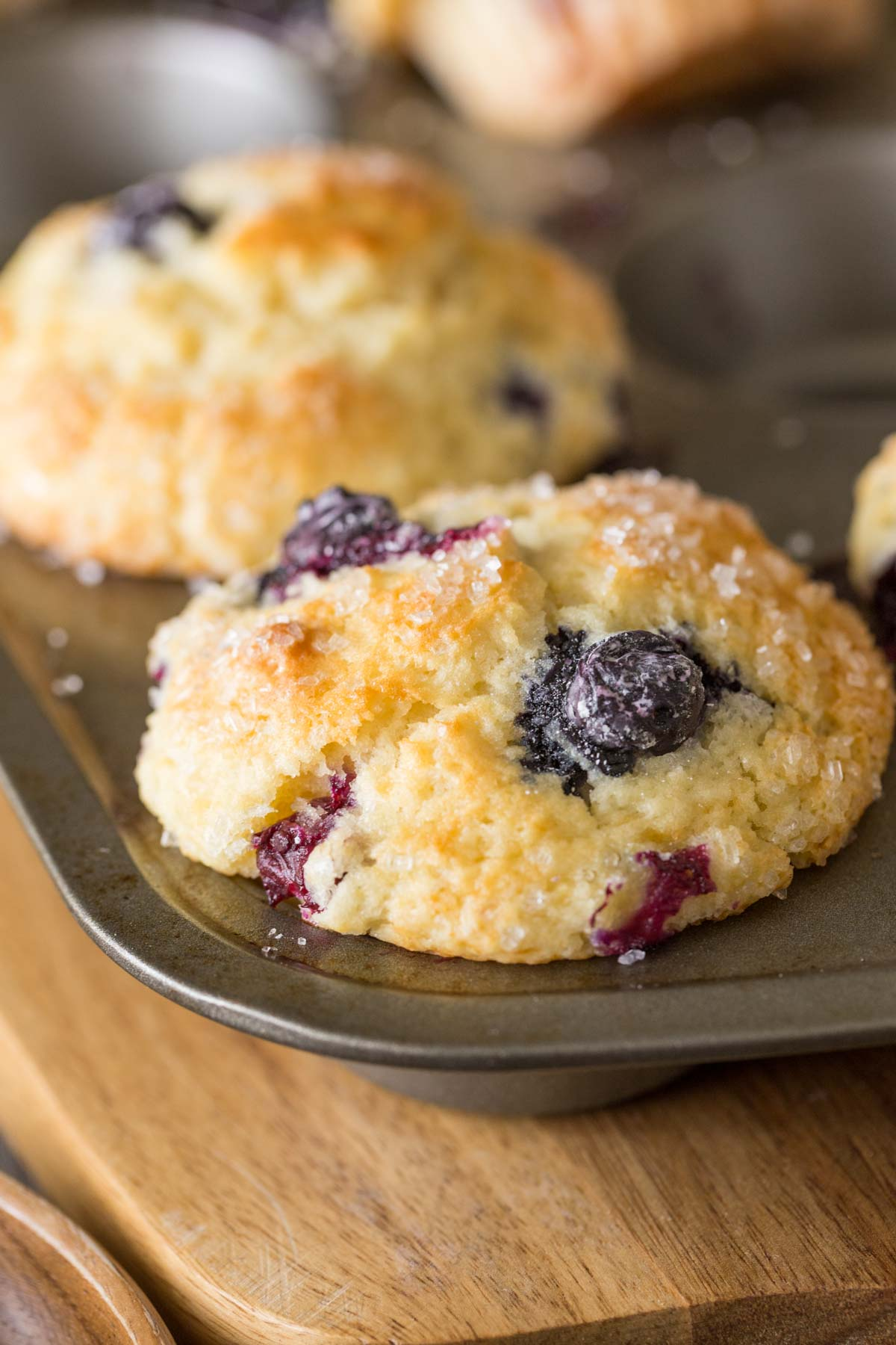A close up shot of the Best Ever Buttermilk Blueberry Muffins in a muffin pan.