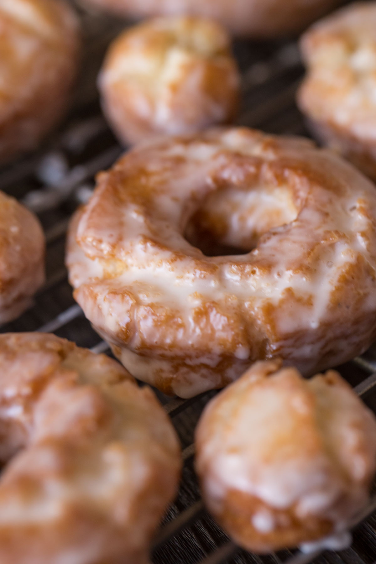 Close up view of an Old Fashioned Buttermilk Donut on a baking rack.