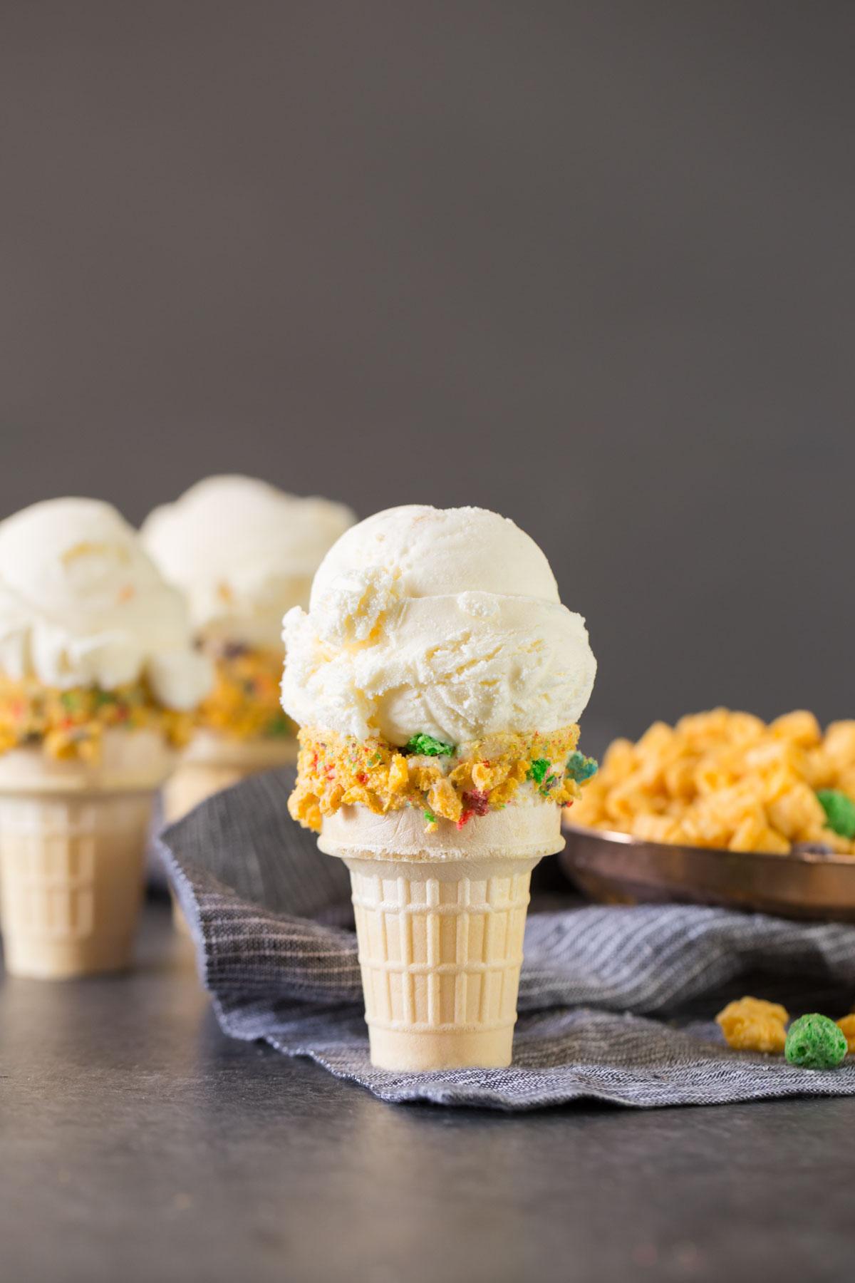 Homemade Cereal Milk Ice Cream in a cone.