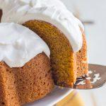 A close up view of a slice of pumpkin spice bundt cake on a cake serve.
