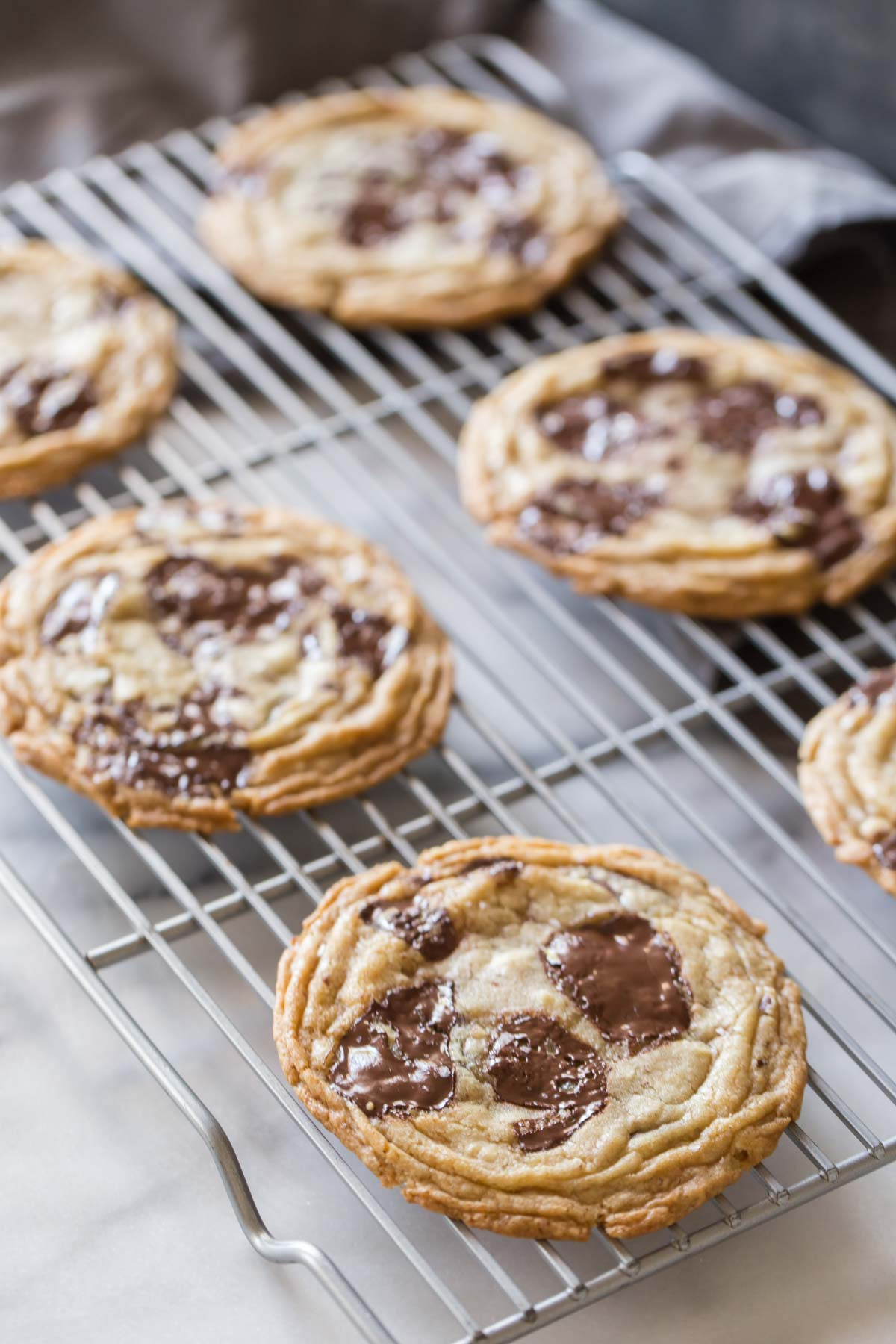 Toffee Almond Chocolate Chunk Cookies on a cooling rack.