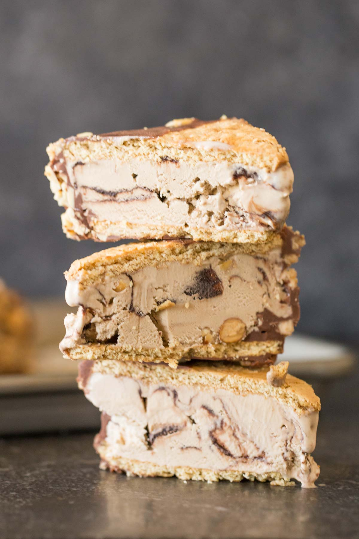 A stack of three Graham Cracker Ice Cream Sandwiches cut in half.