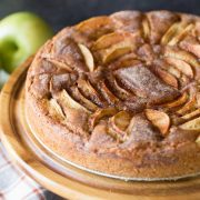Front view of Apple Cider Cake on a wooden cake stand.