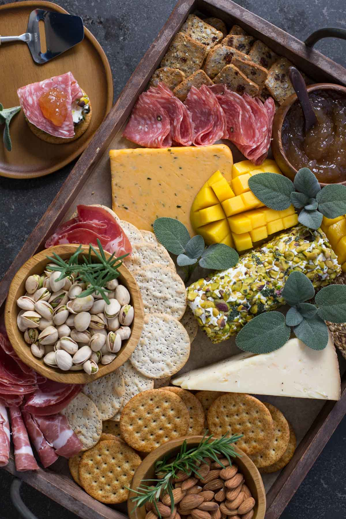 Pistachio Crusted Cheese Log displayed as part of a charcuterie.