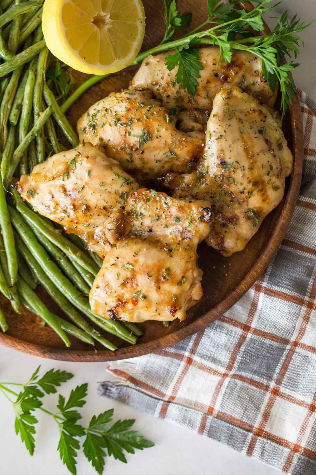 Overhead shot of Best Ever Chicken Marinade on a wooden platter.