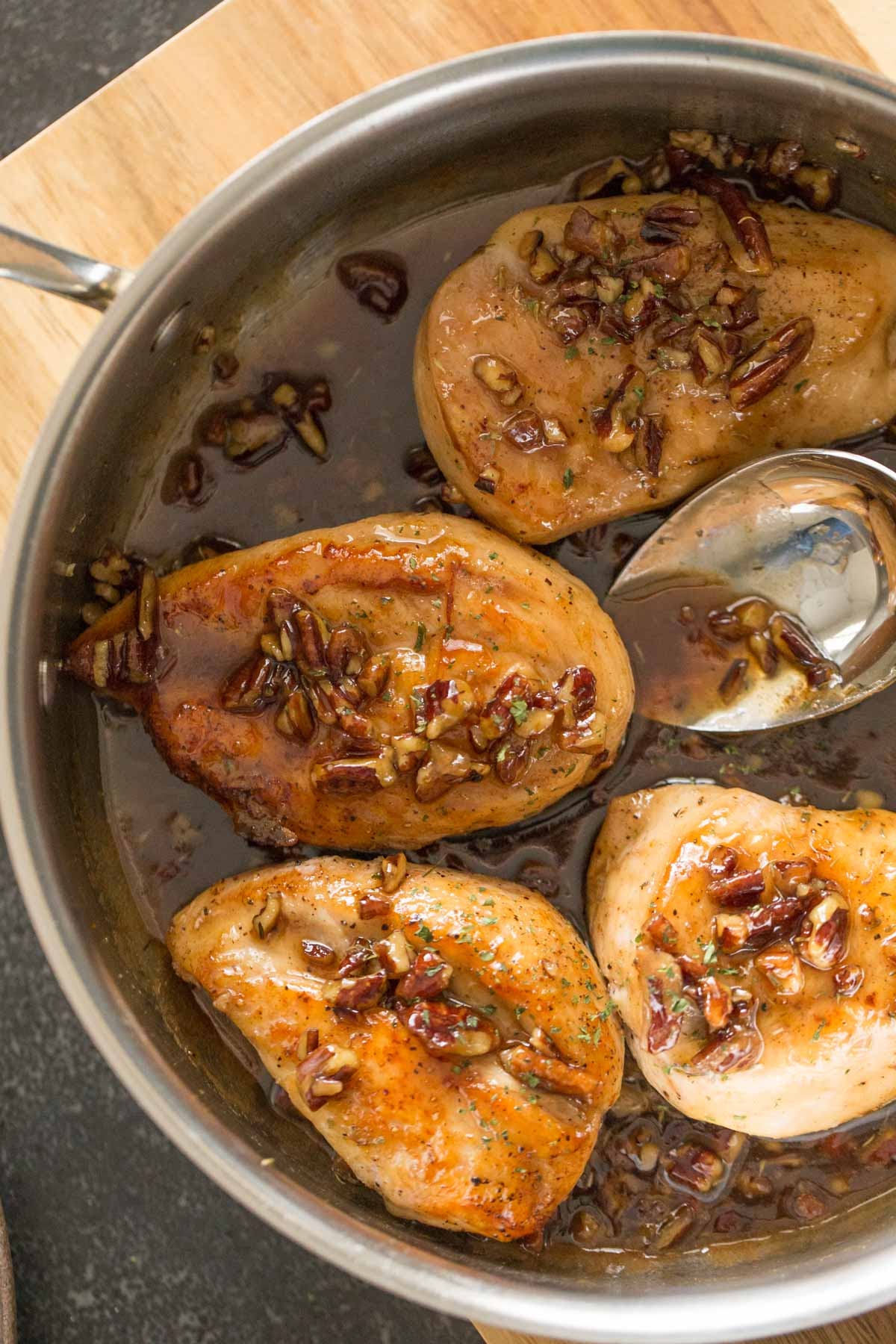 Overhead view of Butter Pecan Chicken in a skillet.