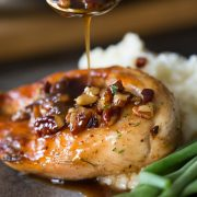 Sweet glaze spooned over Butter Pecan Chicken.