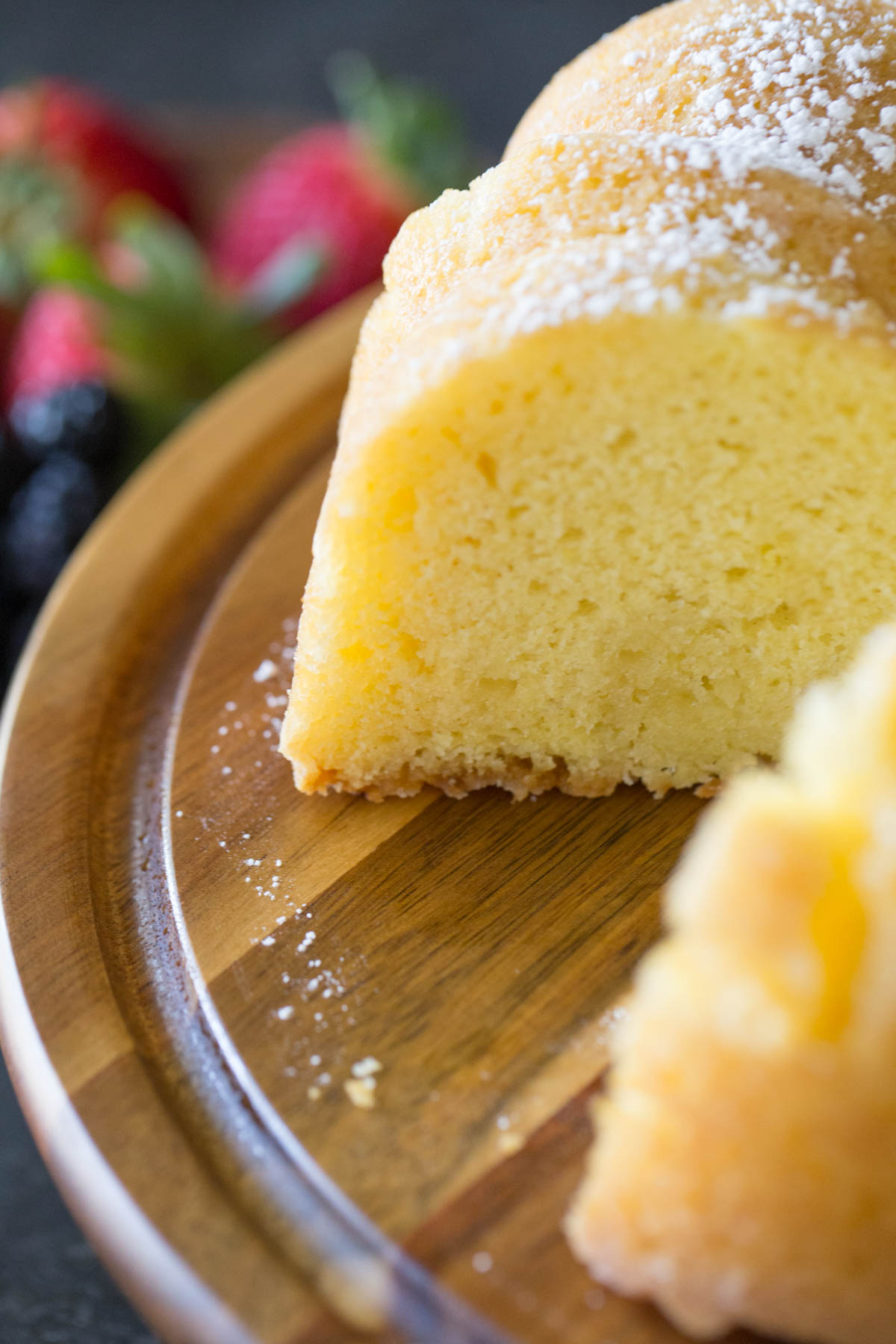Close up view of Kentucky Butter Cake on wooden cake stand.