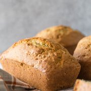 Applesauce Zucchini Bread mini loaf on a grey background.