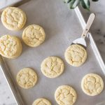 Overhead view of Soft and Chewy Sugar Cookies on a grey baking sheet.