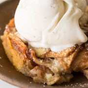Close up view of Apple Cobbler with a scoop of vanilla ice cream on top.