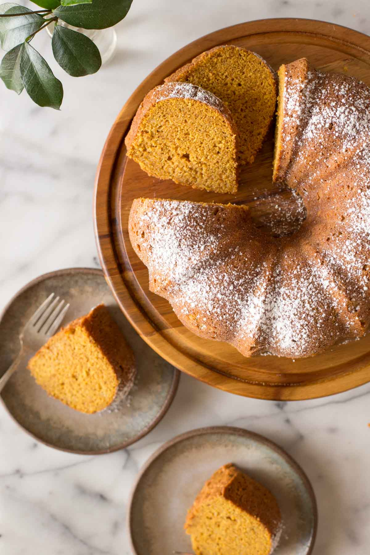 Overhead view of Apple Pumpkin Cake on a wooden cake stand.
