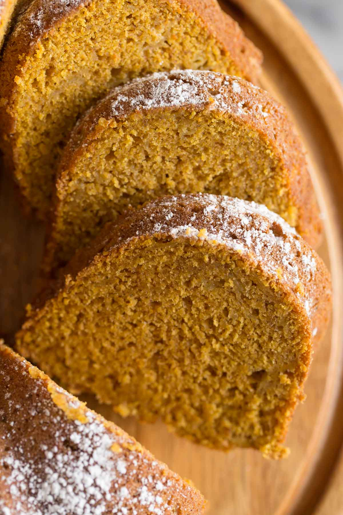 Close up of slices of Apple Pumpkin cake to show moist, tender crumb.
