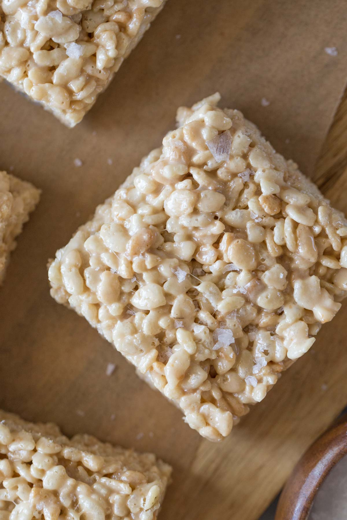 Close up overhead view of Salted Caramel Rice Krispie Treat with flakey sea salt on top.