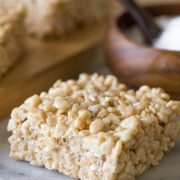 Close up view of Salted Caramel Rice Krispie Treat on a marble board.