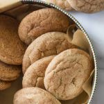 Overhead view of Super Soft Snickerdoodles in a cookie tin on a white marble background.