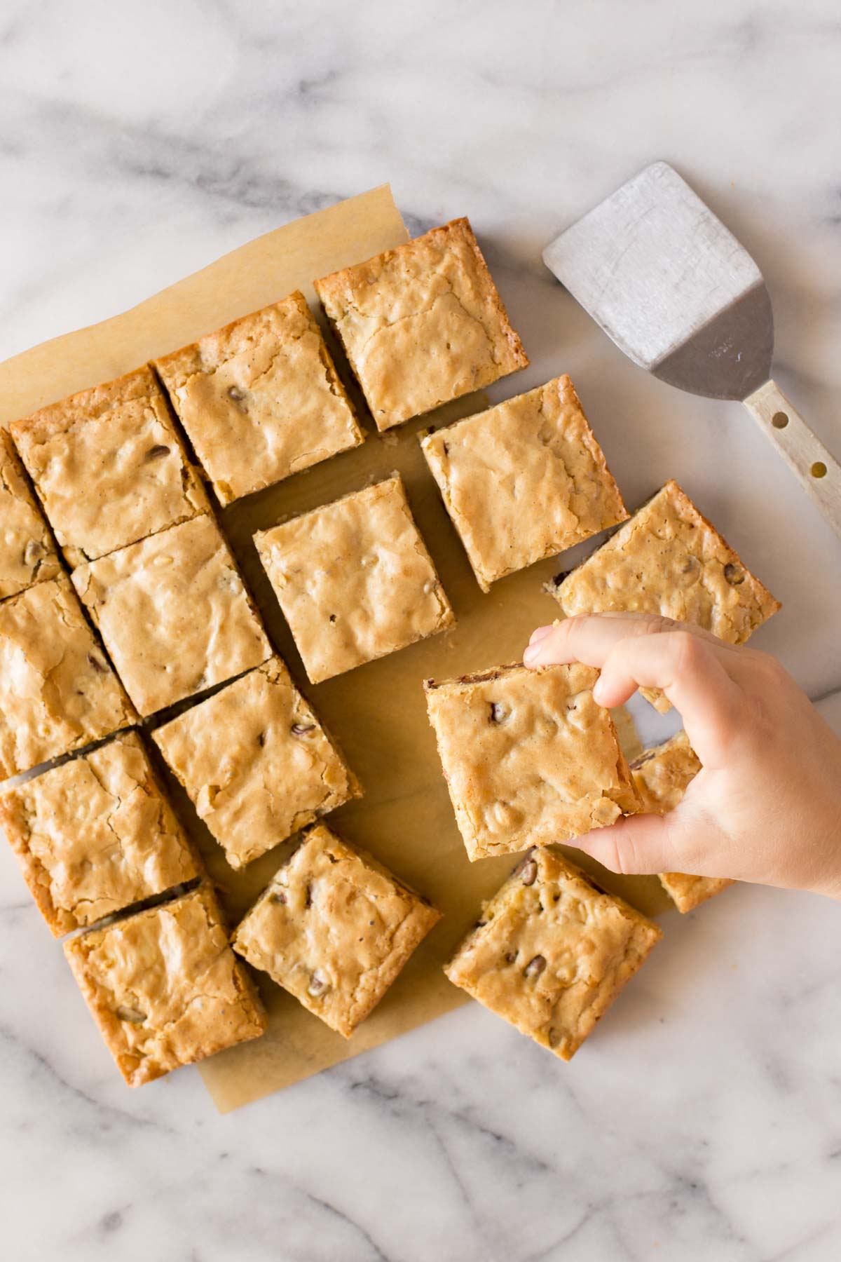 Overhead view of Easy One Bowl Blondies on a white marble background.