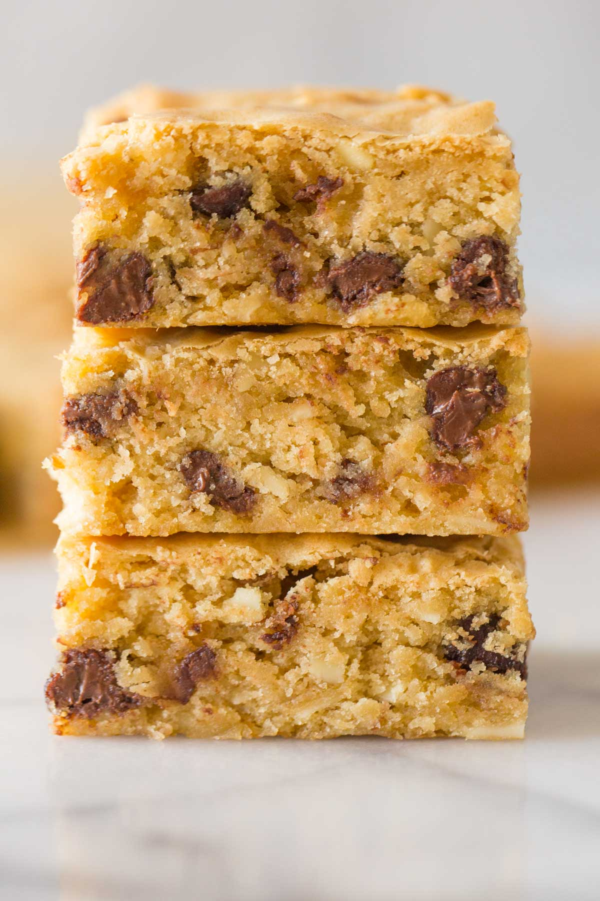 Close up shot of inside of cut Easy One Bowl Blondies stacked three in a row.