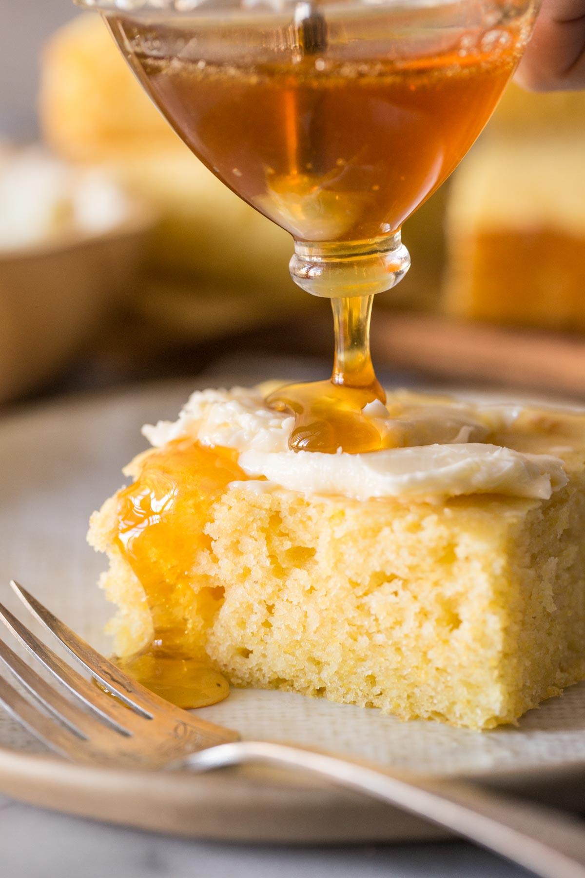 Honey drizzled over Easy Homemade Cornbread slice.
