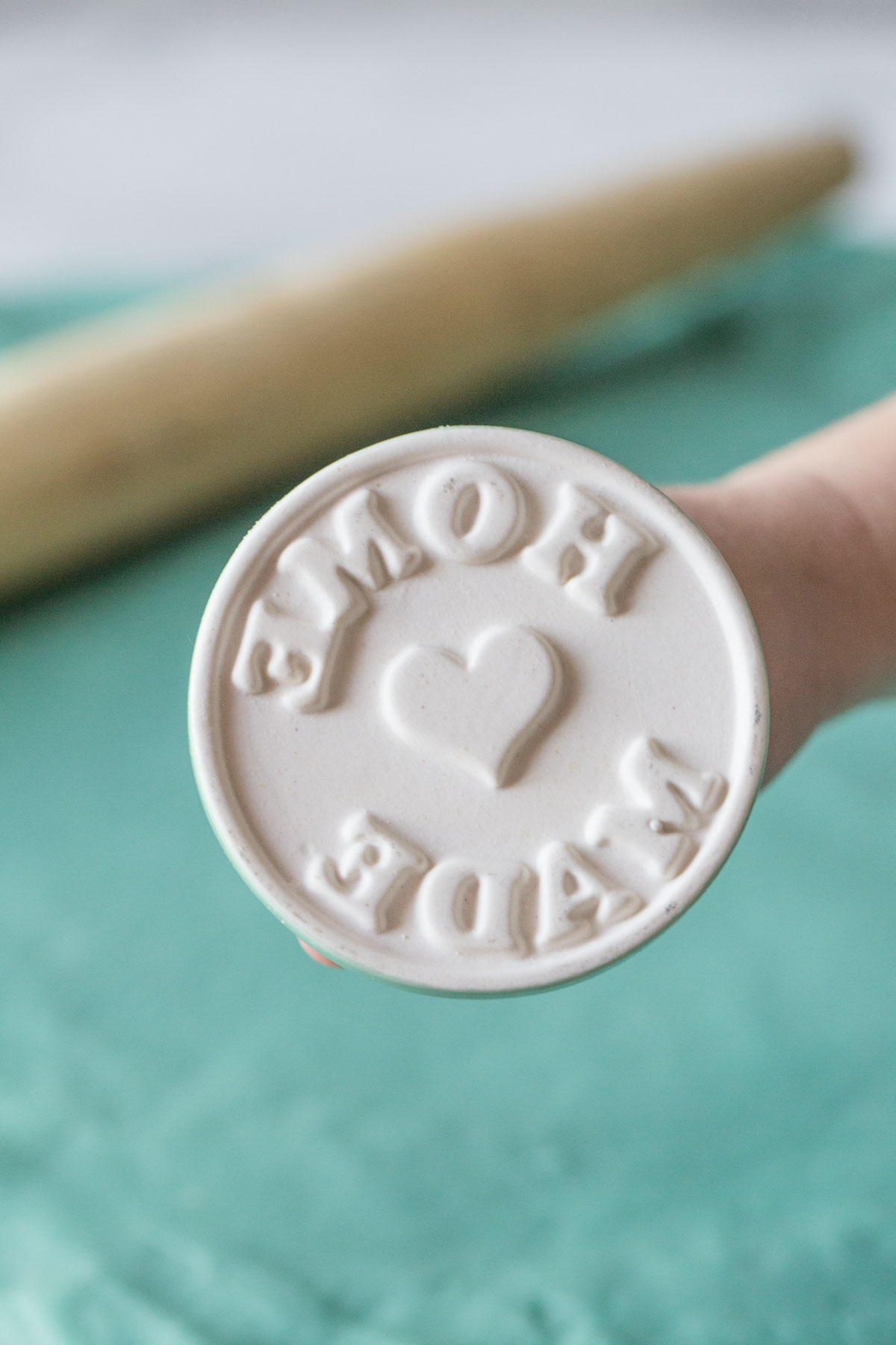 Close up view of playdough stamp that says home made.