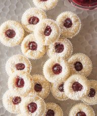 Overhead view of Mini Raspberry Almond Tarts on a sliver tray.