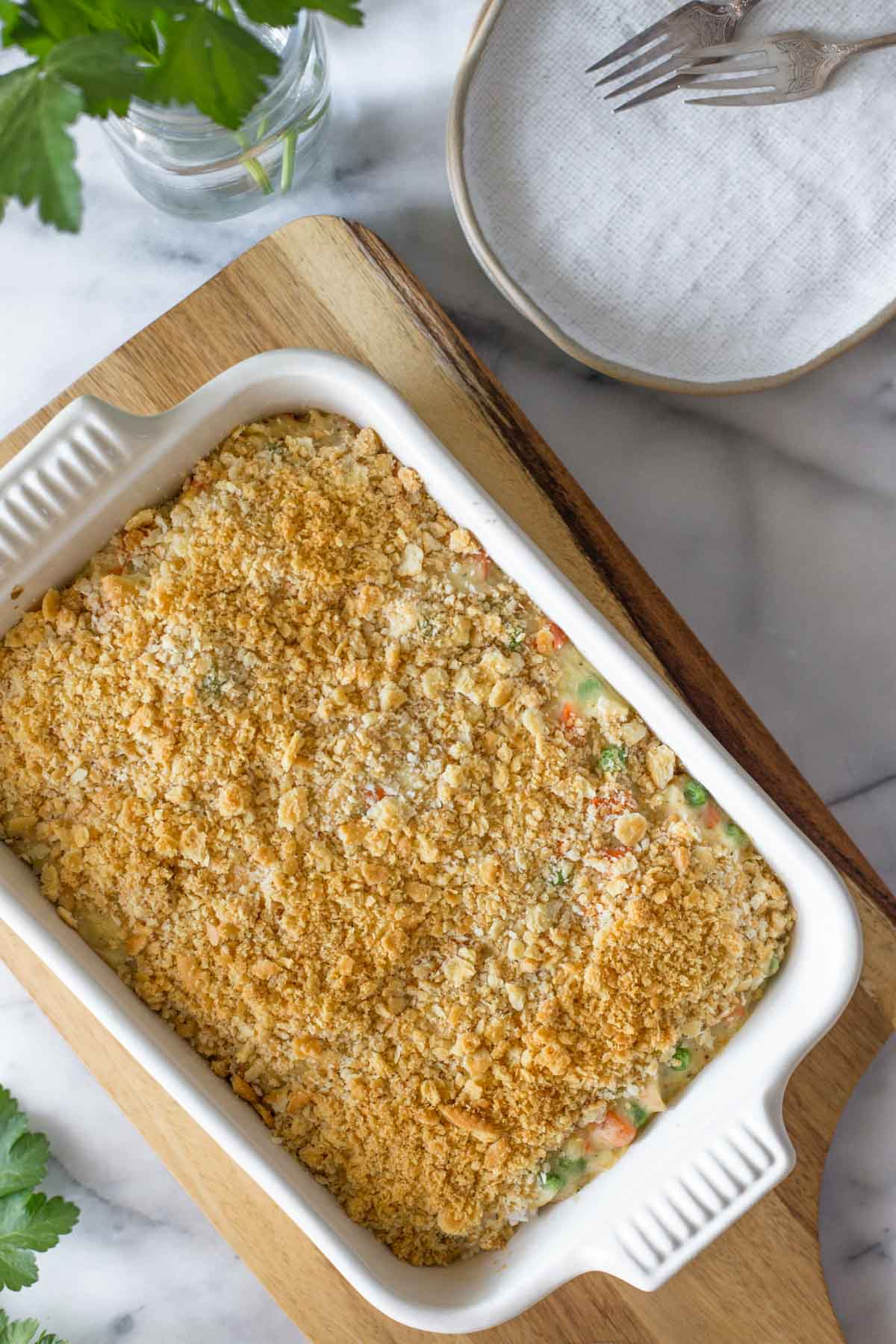 Overhead view of Creamy Chicken and Rice Bake in a white casserole dish.