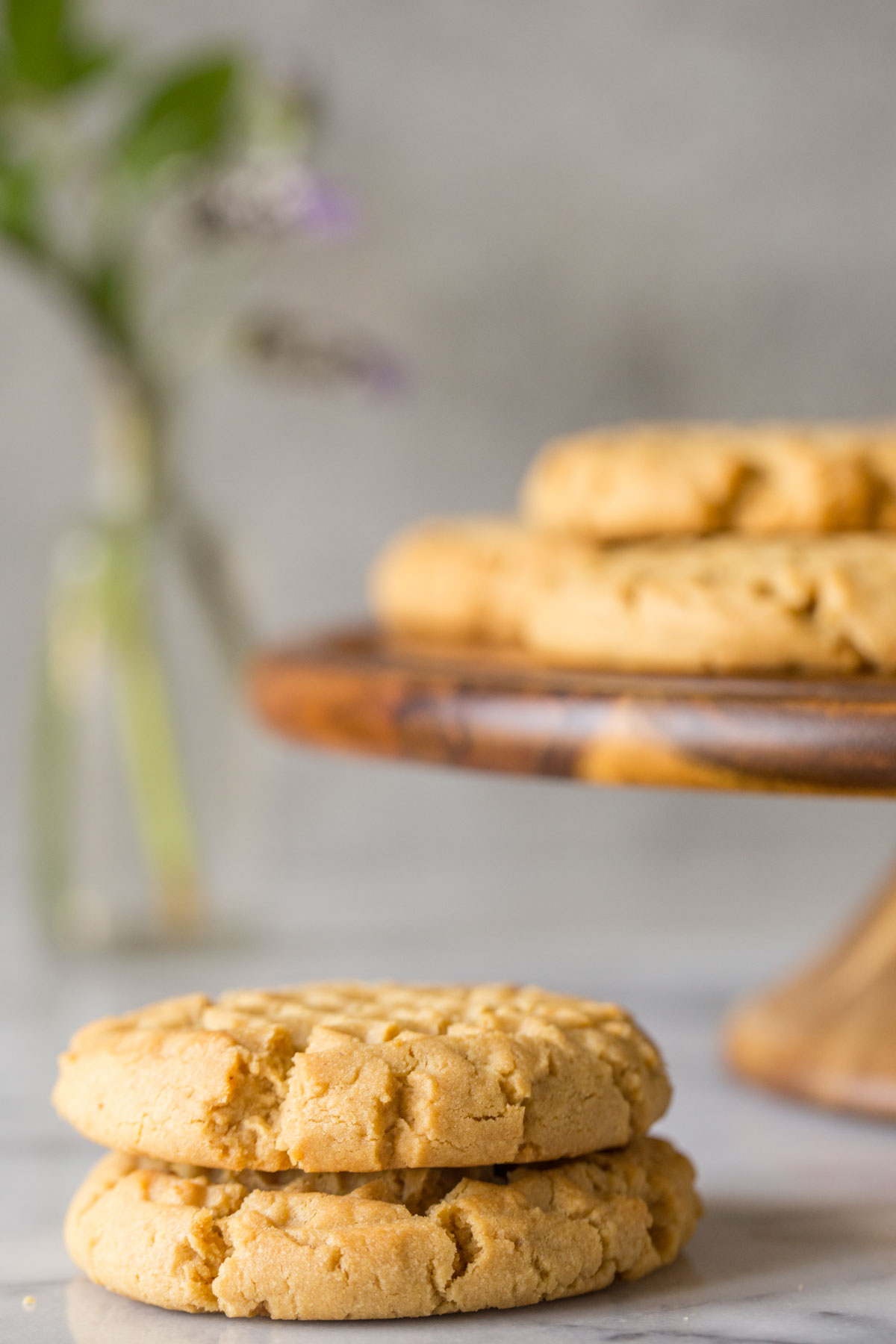 A small stack of Soft and Chewy Peanut Butter Cookies.