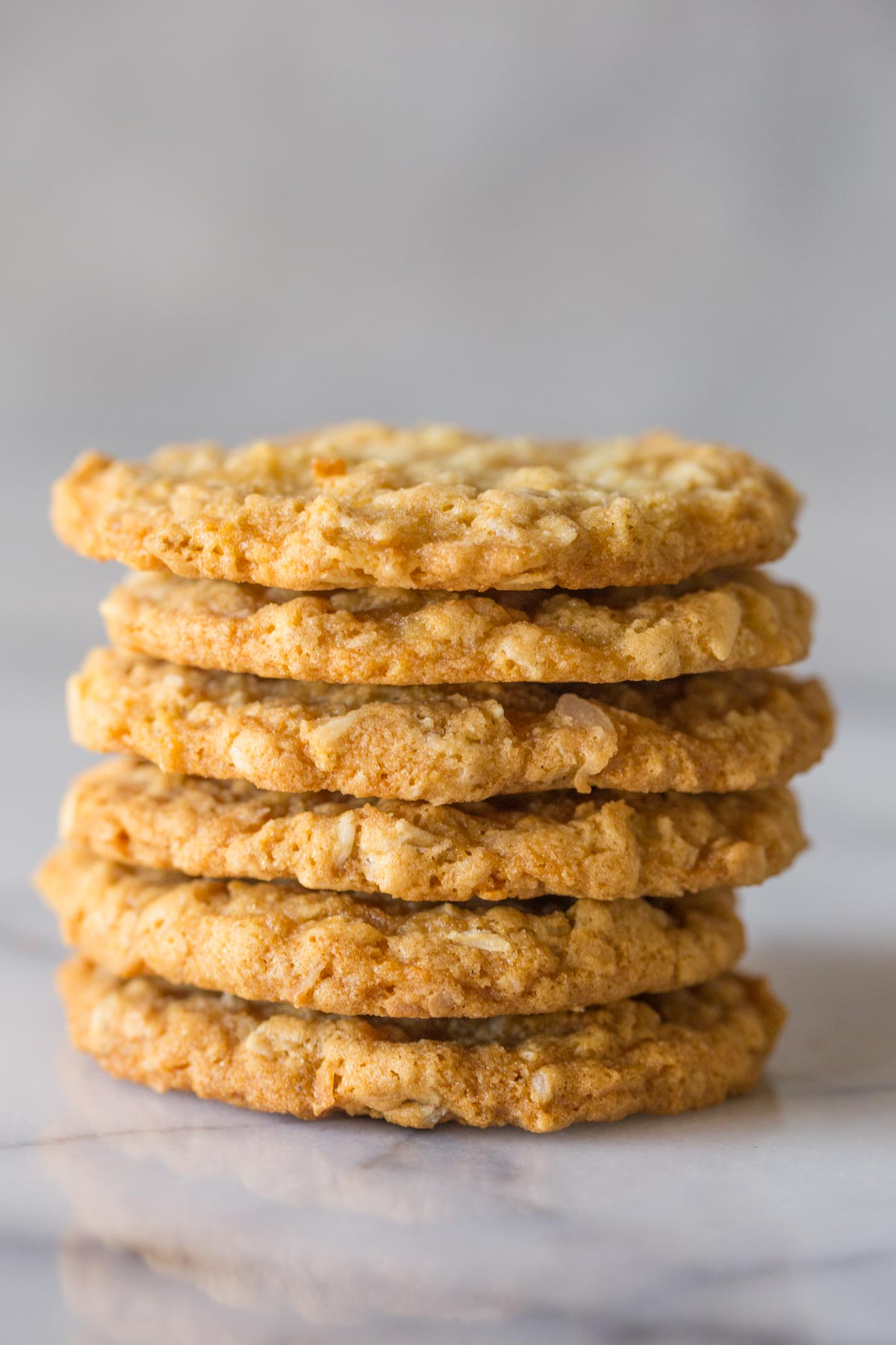 Close up shot of a stack of Buttery Coconut Oatmeal Cookies.