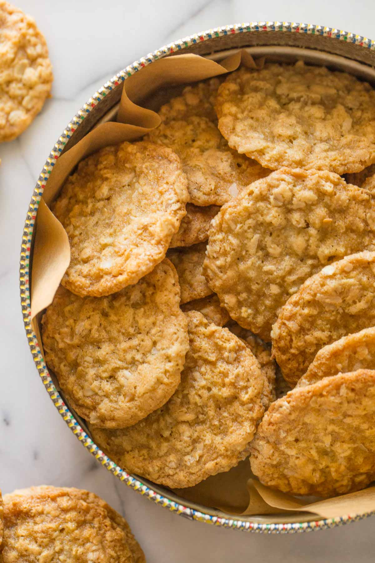 Close up overhead shot of Buttery Coconut Oatmeal Cookies in a container.
