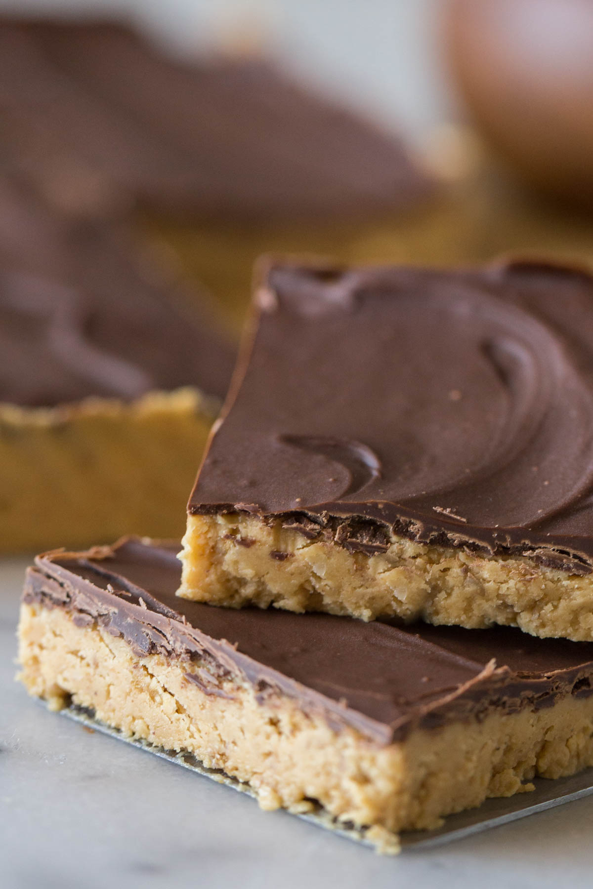 Close up shot of cut bar of Chocolate Peanut Butter Bar.
