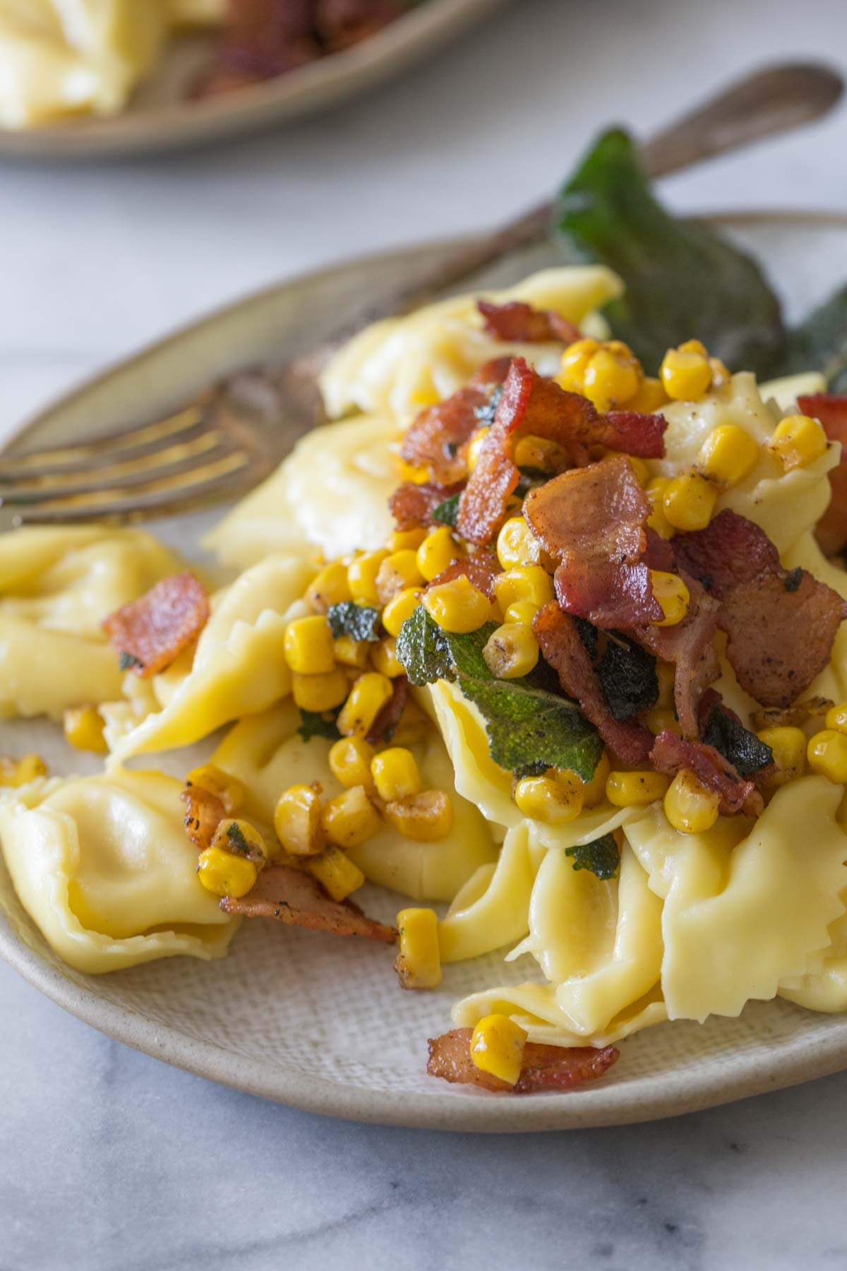 Close up shot of Creamy Tortellini With Bacon and Corn.