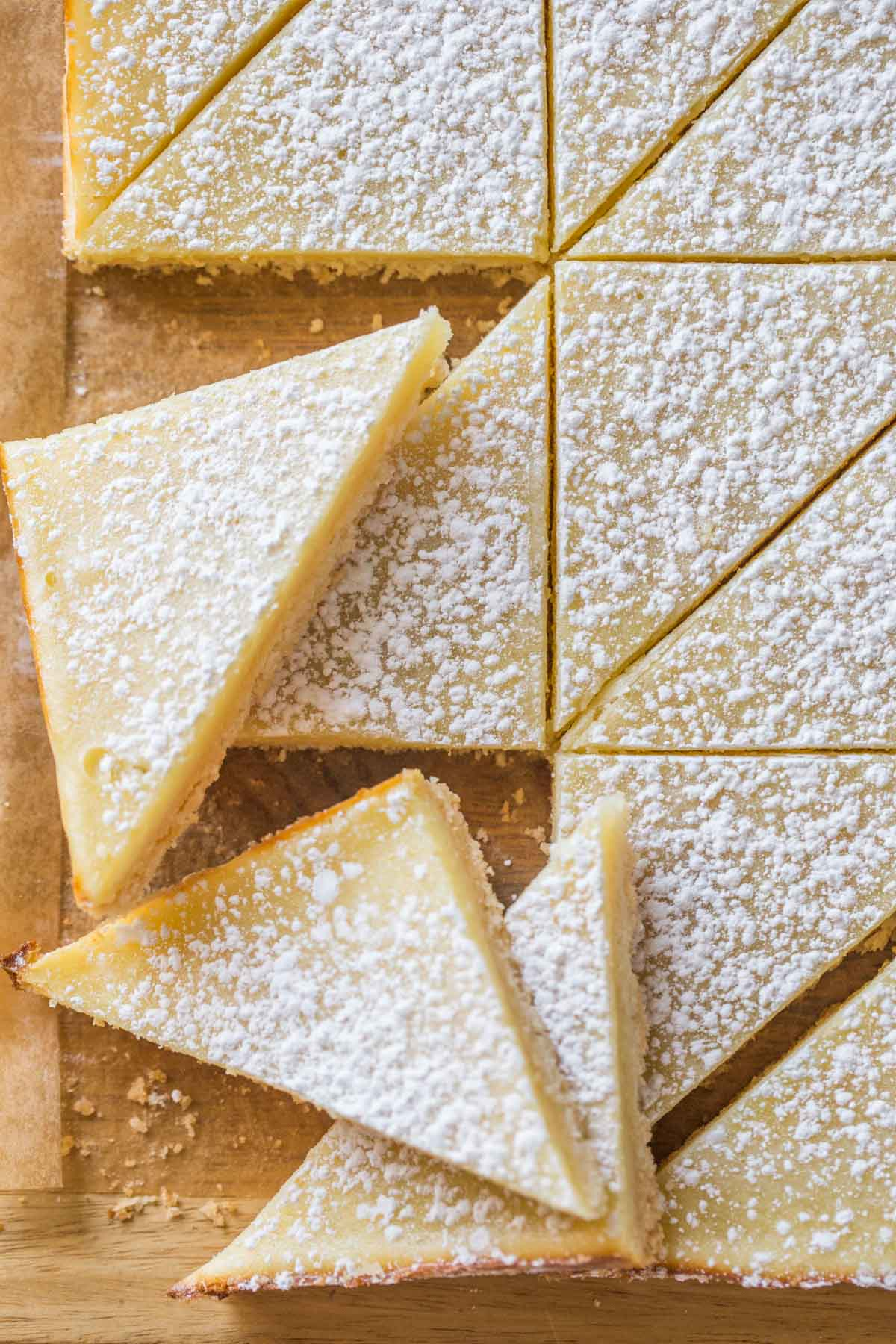 Overhead view of Swedish Lemon Bars on a wooden cutting board.