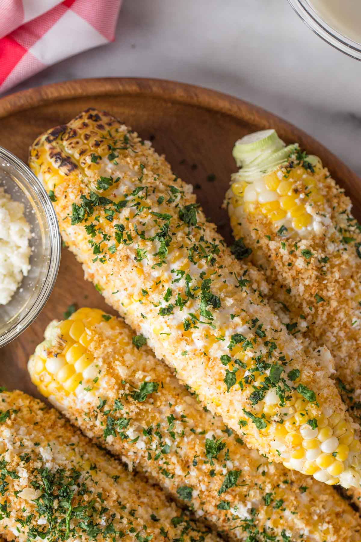 Overhead shot of Mexican Street Corn With Panko on a wood platter.